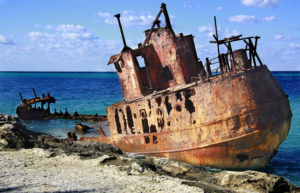 sunken abandoned ship off the beaches of Bimini in crystal waters