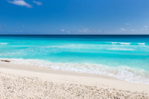 Turquoise, aqua waters off the coast of the untouched beaches of Inagua with gentle waves